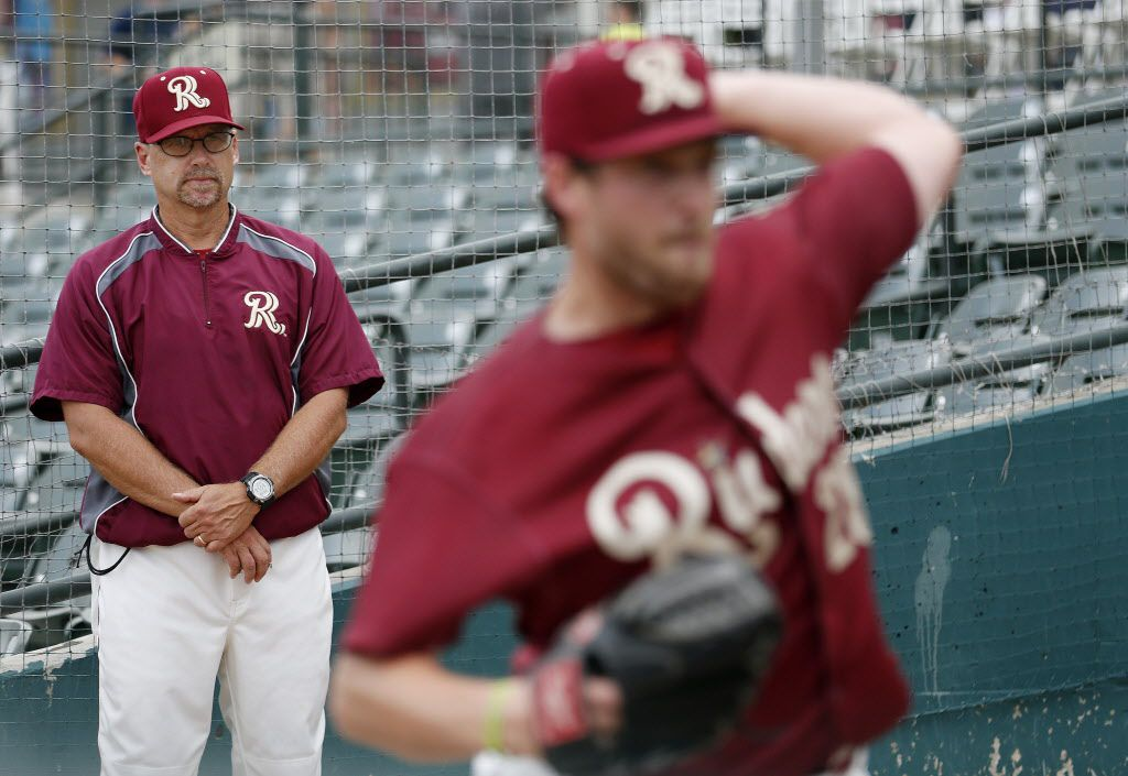 Frisco Roughriders pitching coach Jeff Andrews observes starting pitcher Chad Bell in the bullpen while Bell warms up before a game between the Northwest Arkansas Naturals and the Roughriders at Dr Pepper Ballpark in Frisco, Texas Thursday July 2, 2015. (Andy Jacobsohn/The Dallas Morning News)