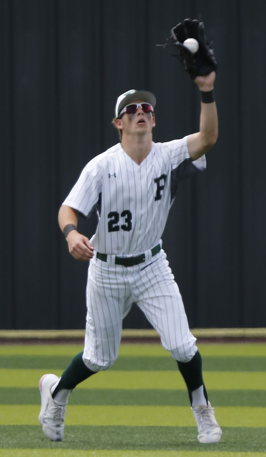 Prosper right fielder Harrison Rosar (23) catches a fly ball for an out in the second inning as Prosper High School hosted Arlington Martin High School in a series final 6A Region I area round playoff game on Saturday afternoon, May 15, 2021. (Stewart F. House/Special Contributor)