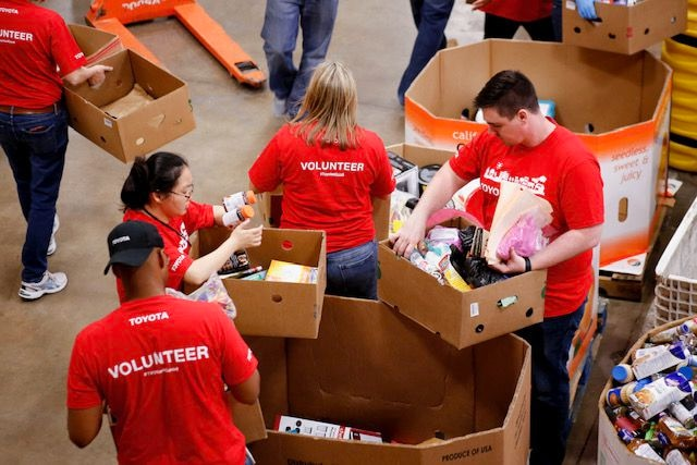 Toyota employees volunteer at the North Texas Food Bank.