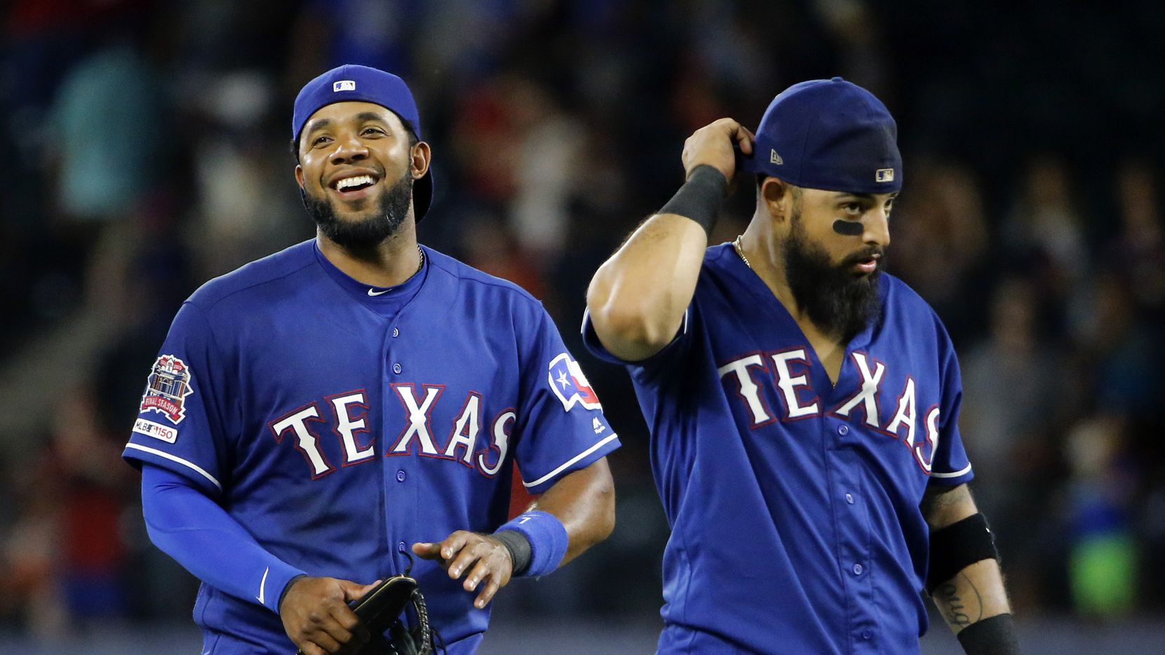 Texas Rangers shortstop Elvis Andrus (left) and second baseman Rougned Odor (right) are pictured following their win over the Houston Astros at Globe Life Park in Arlington, Texas, Thursday, July 11, 2019.