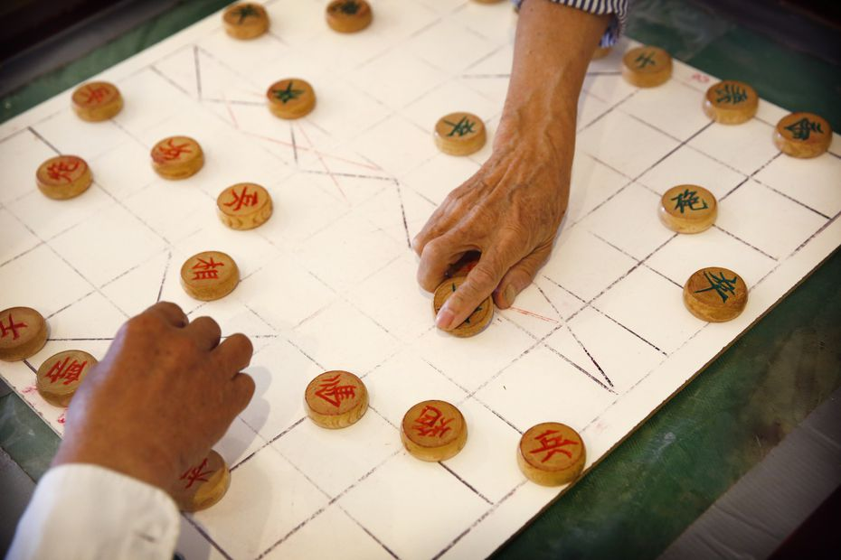 Seniors at the Golden Age senior center on in Arlington play a game together.