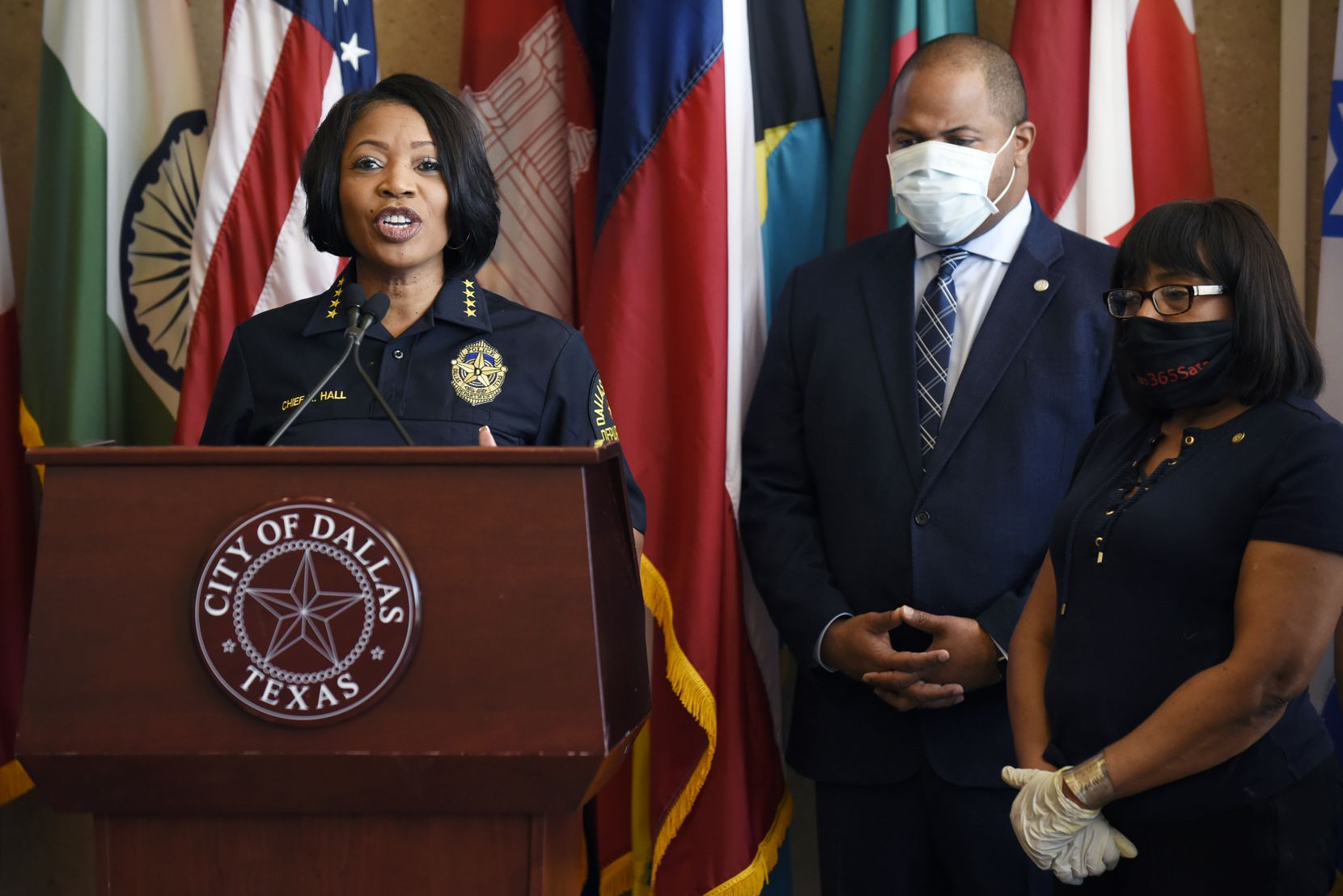 Dallas Chief of Police Renee Hall, left, and Dallas Mayor Eric Johnson, right, conduct a press conference in May, addressing the protests over the killing of George Floyd. Johnson is a staunch defender of the police department, opposing any cuts to its budget.