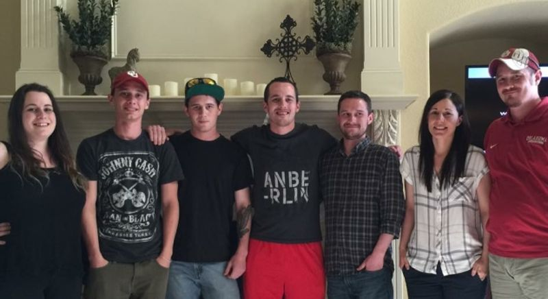 Pictured here with his family in 2016, Jonah Israel - one of sport's original memes - is second from left.