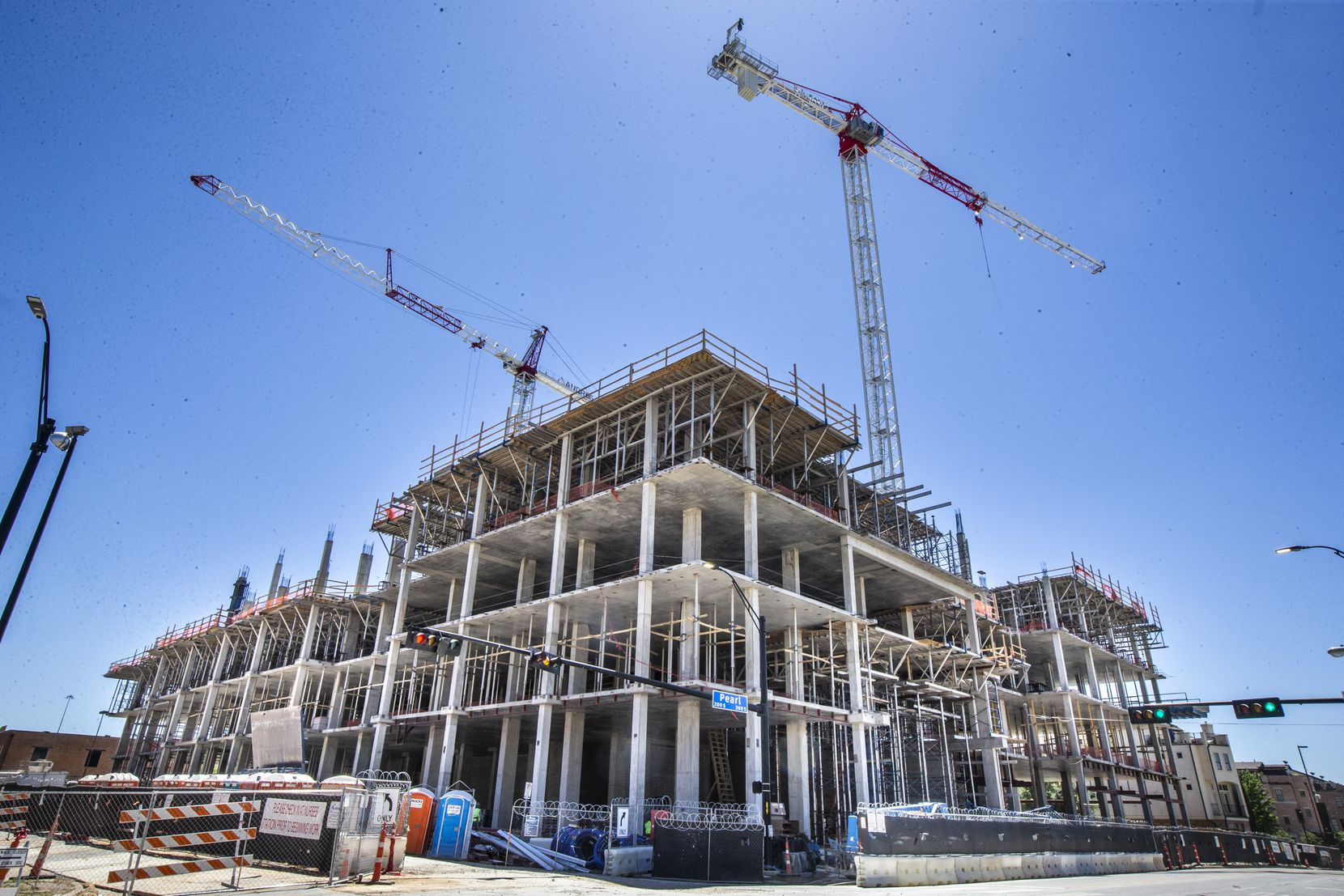 A project under construction in downtown Dallas' East Quarter is one of more than two dozen  office buildings under construction in D-FW.