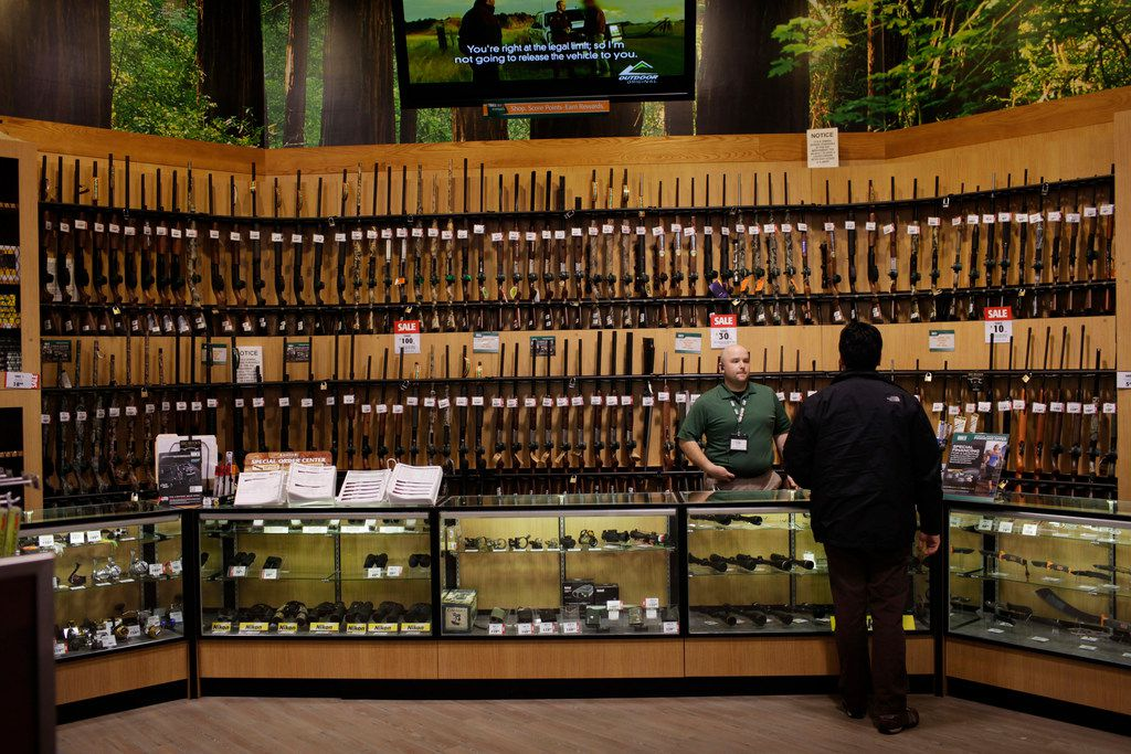 A customer looks at guns at a Dick's Sporting Goods in Paramus, N.J.,. on Tuesday, March 6, 2012.