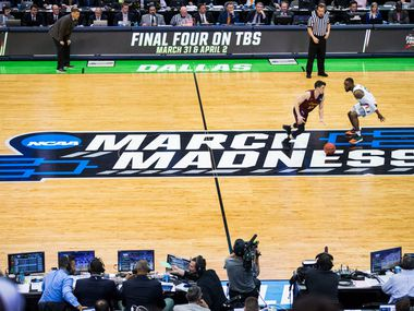 Loyola (Il) Ramblers guard Clayton Custer (13) makes it past Miami (Fl) Hurricanes guard Ja'Quan Newton (0) during the first half of an NCAA men's basketball tournament first round game between Loyola and Miami on Thursday, March 15, 2018 at the American Airlines Center in Dallas.