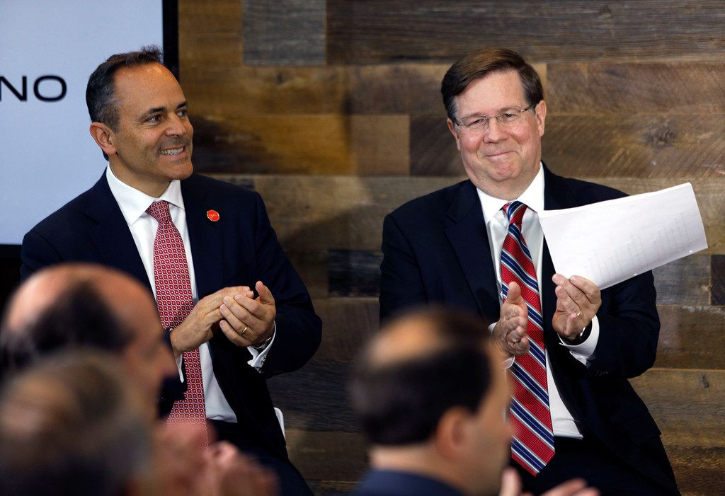 Toyota CEO Jim Lentz (right) and Kentucky Gov. Matt Bevin (left) applaud a speaker at the unveiling of a new Toyota  engineering headquarters Monday in Georgetown, Kentucky.