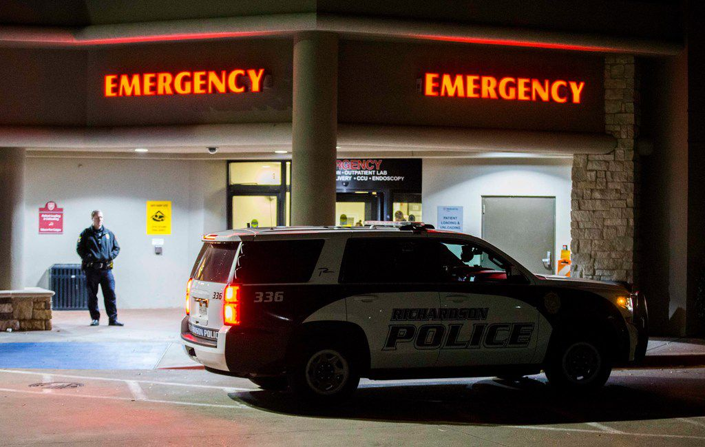 Police officers gather at the emergency room at Medical City Plano hospital in Plano after a Richardson police officer was shot and killed on Feb. 7, 2018 at an apartment complex in Richardson. (Ashley Landis/The Dallas Morning News)