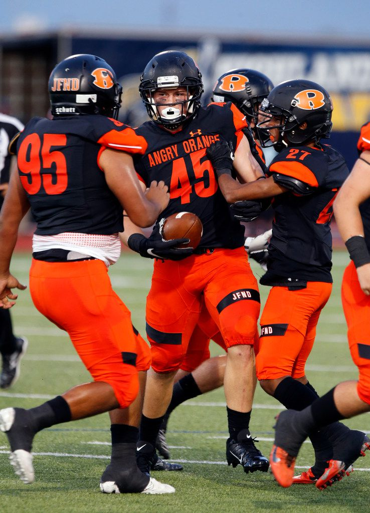 Rockwall linebacker Jake Edwards (45) is congratulated by teammates after grabbing a Highland Park turnover during the first half of their high school football game at Wilkerson-Sanders Stadium in Rockwall on Friday, August 30, 2019. (John F. Rhodes / Special Contributor)