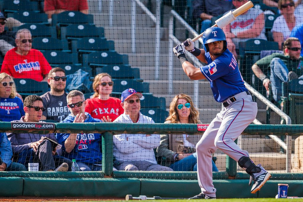 Texas Rangers general manager Jon Daniels (left) watches as Texas Rangers outfielder Bubba Thompson takes practice swings in the ondeck circle during the eighth inning of a spring training baseball game against the Cleveland Indians on Monday, Feb. 25, 2019, in Goodyear, Ariz.. (Smiley N. Pool/The Dallas Morning News)