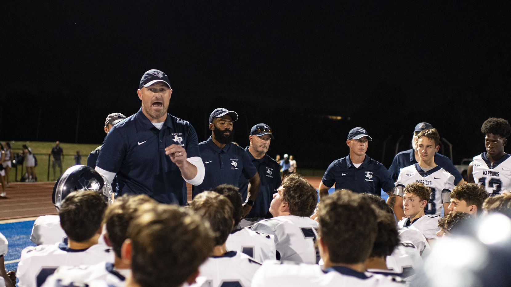 Argyle Liberty Christian Head Coach Jason Witten talks to his players at the conclusion of Parish Episcopal's home game against Argyle Liberty Christian at Gloria Snyder Stadium on Friday, September 17, 2021 in Dallas, Texas.  Parish Episcopal won the game by a final of 45-14.