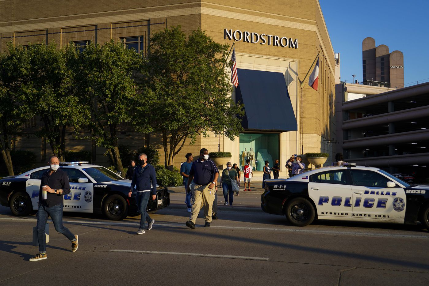Dallas police direct people away from the Nordstrom store at the Galleria Dallas on Tuesday, June 16, 2020, in Dallas.