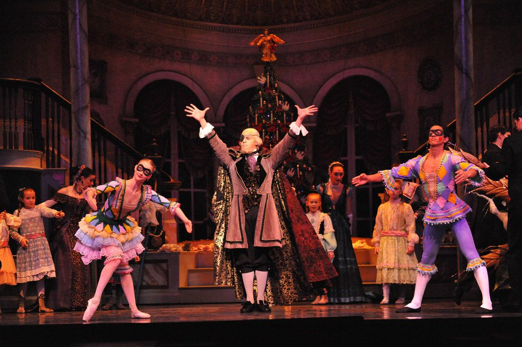 Joanmanuel Velazquez appears as Harlequin (at right) In the Texas Ballet Theater's 2017 production of The Nutcracker.