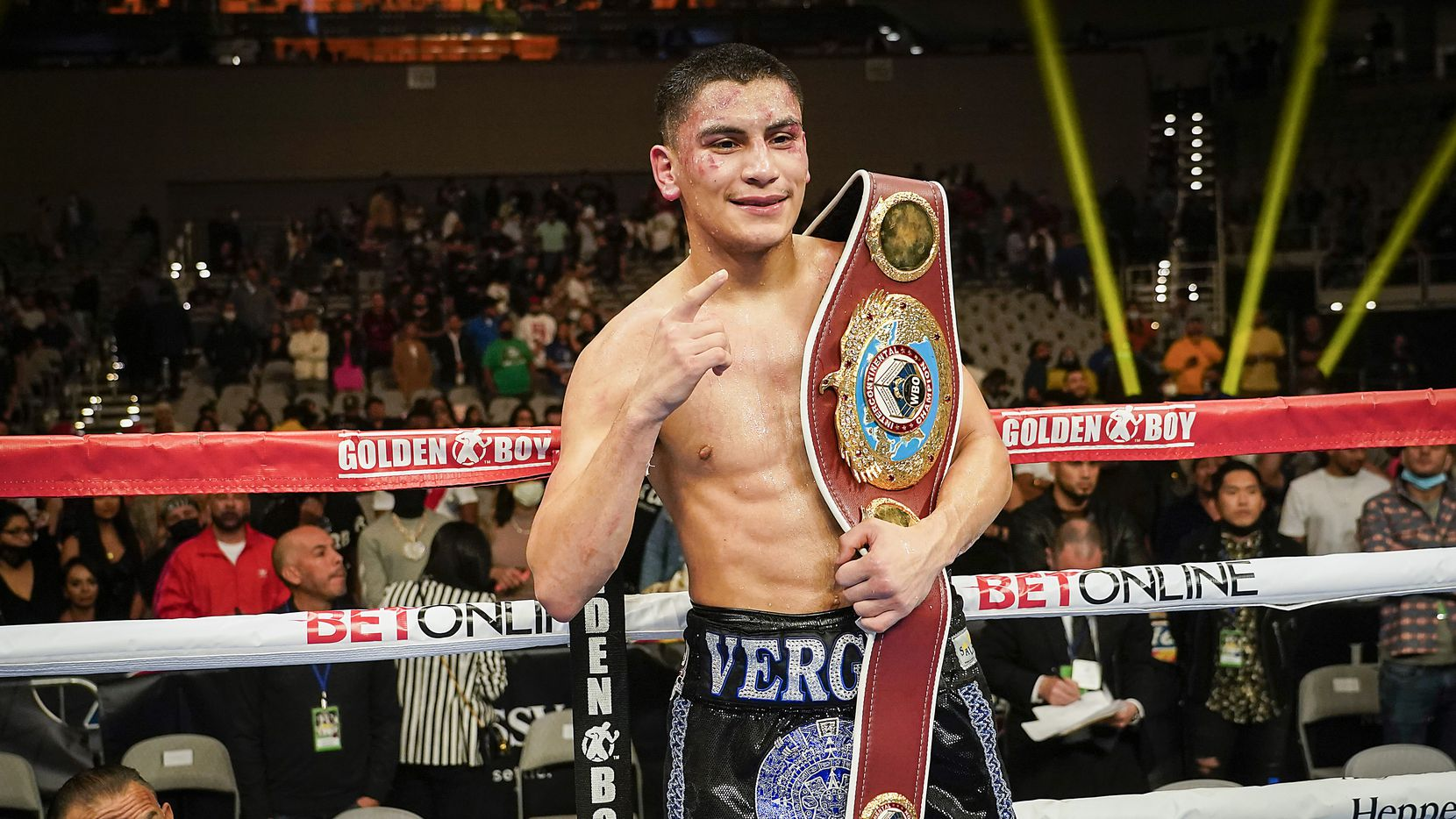 Vergil Ortiz Jr. celebrates with the title belt after knocking out Maurice Hooker in the seventh round for the vacant WBO international welterweight title at Dickies Arena on Saturday, March 20, 2021, in Fort Worth.