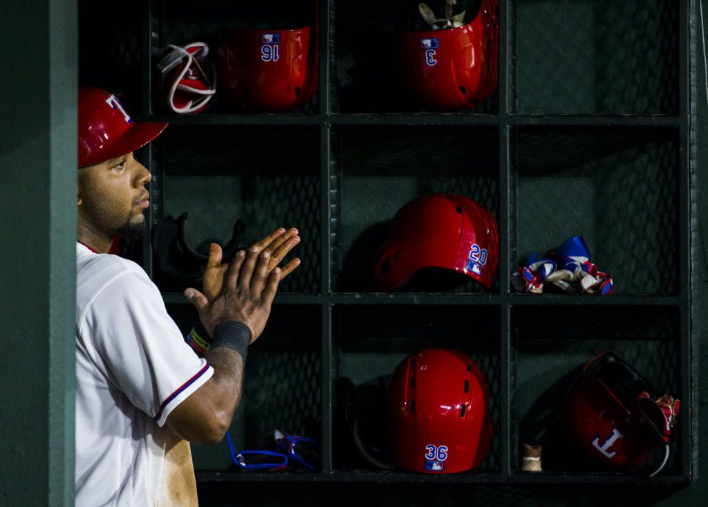 Texas Rangers shortstop Elvis Andrus (1) watches from the dugout during the third inning of their game against the Seattle Mariners on Monday, August 29, 2016 at Globe Life Park in Arlington, Texas.  (Ashley Landis/The Dallas Morning News)