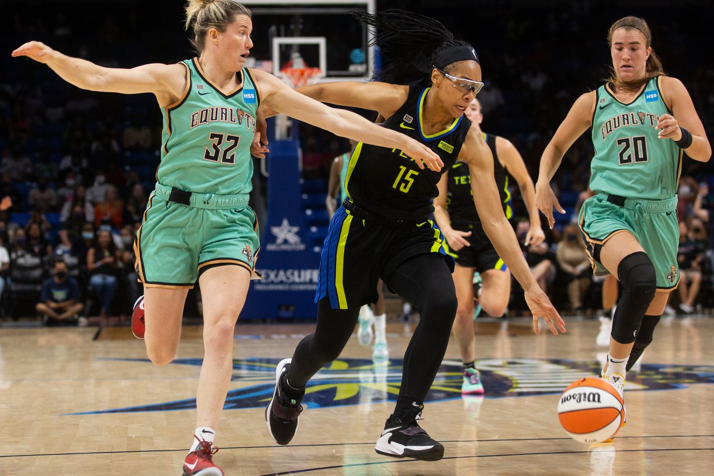 Dallas Wings guard Allisha Gray (15) pushes against NY Liberty NY Liberty guard Sami Whitcomb (32) to the ball down the court at College Park Center in Arlington, TX on September 11, 2021.  (Shelby Tauber/Special Contributor)