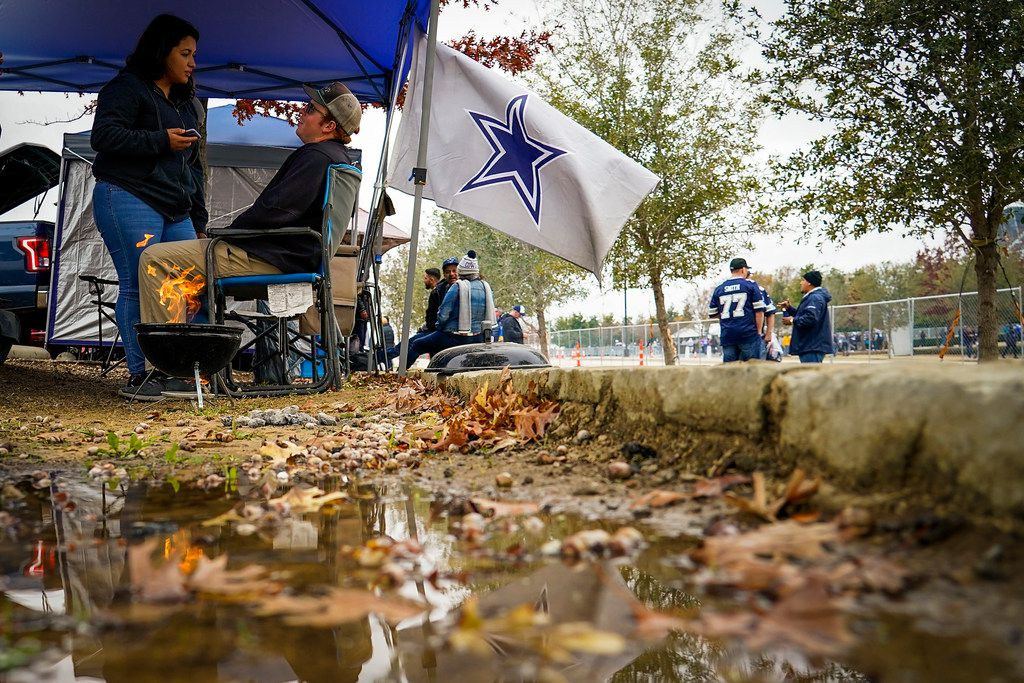 Fans tailgate before an NFL football game between the Dallas Cowboys and the Buffalo Bills at AT&T Stadium on Thursday, Nov. 28, 2019, in Arlington. (Smiley N. Pool/The Dallas Morning News)