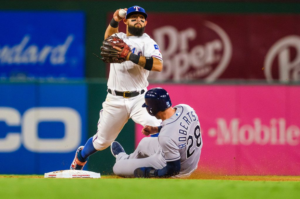 Texas Rangers second baseman Rougned Odor canÕt turn the double play over Tampa Bay Rays third baseman Daniel Robertson during the ninth inning at Globe Life Park on Wednesday, Sept. 11, 2019, in Arlington. (Smiley N. Pool/The Dallas Morning News)