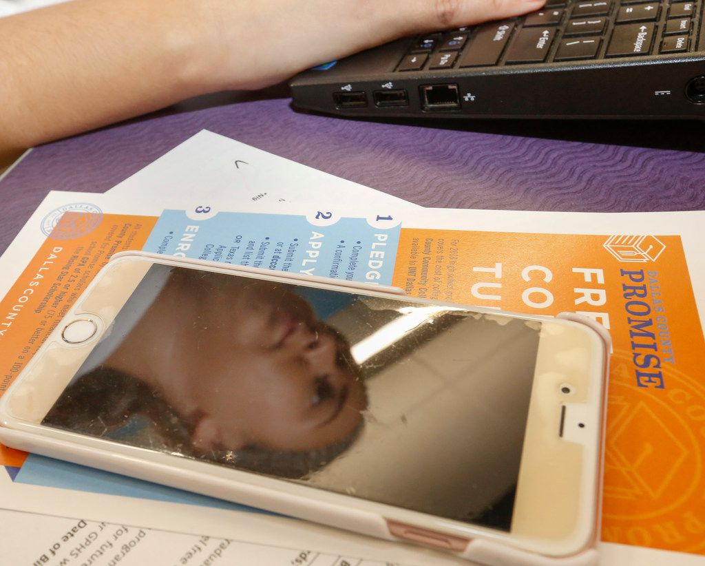 Grand Prairie High School senior Briana Rocha is reflected in her cellphone screen as she fills fill out the Dallas County Promise Pledge before her Senior Chat with her counselors Oct. 27, 2017. The Promise Pledge is a non-binding contract on attending Dallas County Community College District schools and receiving tuition cost, part of the Dallas County Promise program. (Staff Photo)