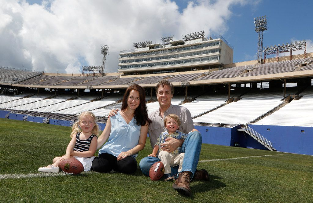Michael Meredith, son of Cowboys great Don Meredith poses for a family portrait with his wife, Amit Nizan Meredith, and their children Marlowe, 2, left, and Walker, 18 months, at the Cotton Bowl in Fair Park in Dallas on Tuesday, June 13, 2017. (David Woo/The Dallas Morning News)
