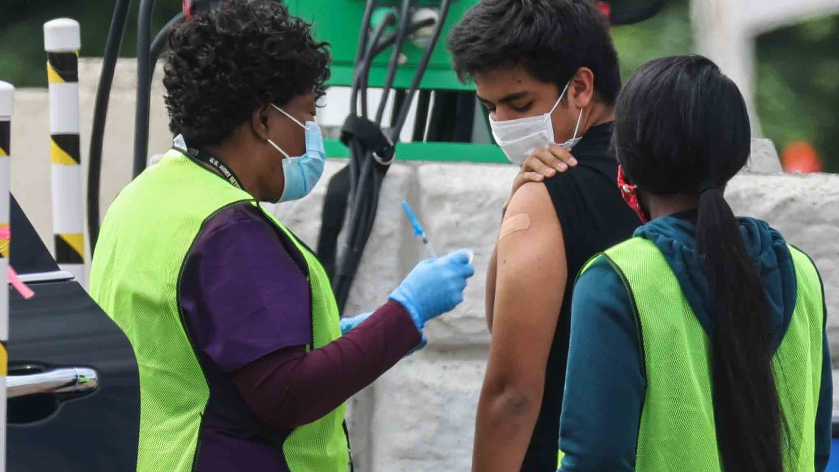 A nurse gives a COVID-19 vaccine to a man at Fair Park in Dallas on May 14.