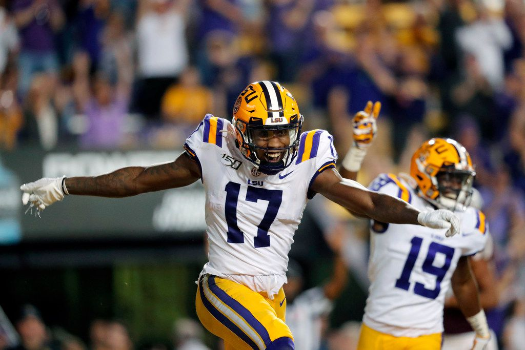 LSU wide receiver Racey McMath (17) celebrates his touchdown reception with wide receiver Derrick Dillon (19) during the second half of the team's NCAA college football game against Texas A&M in Baton Rouge, La., Saturday, Nov. 30, 2019. LSU won 50-7. (AP Photo/Gerald Herbert)