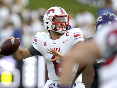 SMU quarterback Tanner Mordecai (8) looks to pass during the first half against Abilene Christian University. The two teams played their season opening football game at SMU's Ford Stadium in Dallas on September 4, 2021. (Steve Hamm/ Special Contributor)
