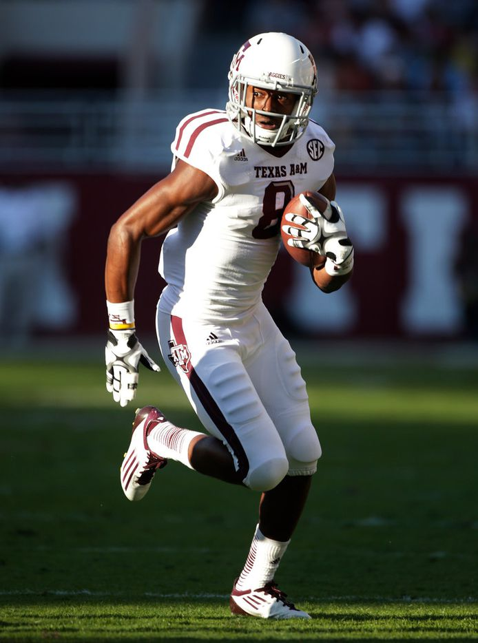 FILE - In this Nov. 10, 2012, file photo, Texas A&M wide receiver Thomas Johnson (8) carries for extra yardage after a reception during the first half of an NCAA college football game against Alabama in Tuscaloosa, Ala. The former Texas A&M football player has arrived in court to be tried for the killing of a jogger police say was hacked to death with a machete in 2015. Johnson's murder trial began Monday, April 29, 2019, after years of litigation over whether the 25-year old former wide receiver is mentally competent to be tried for the killing of David Stevens. (AP Photo/Dave Martin, File)