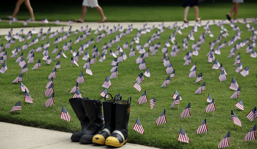 SMU students walk by a display of boots and flags on September 10, 2010 on the SMU campus.