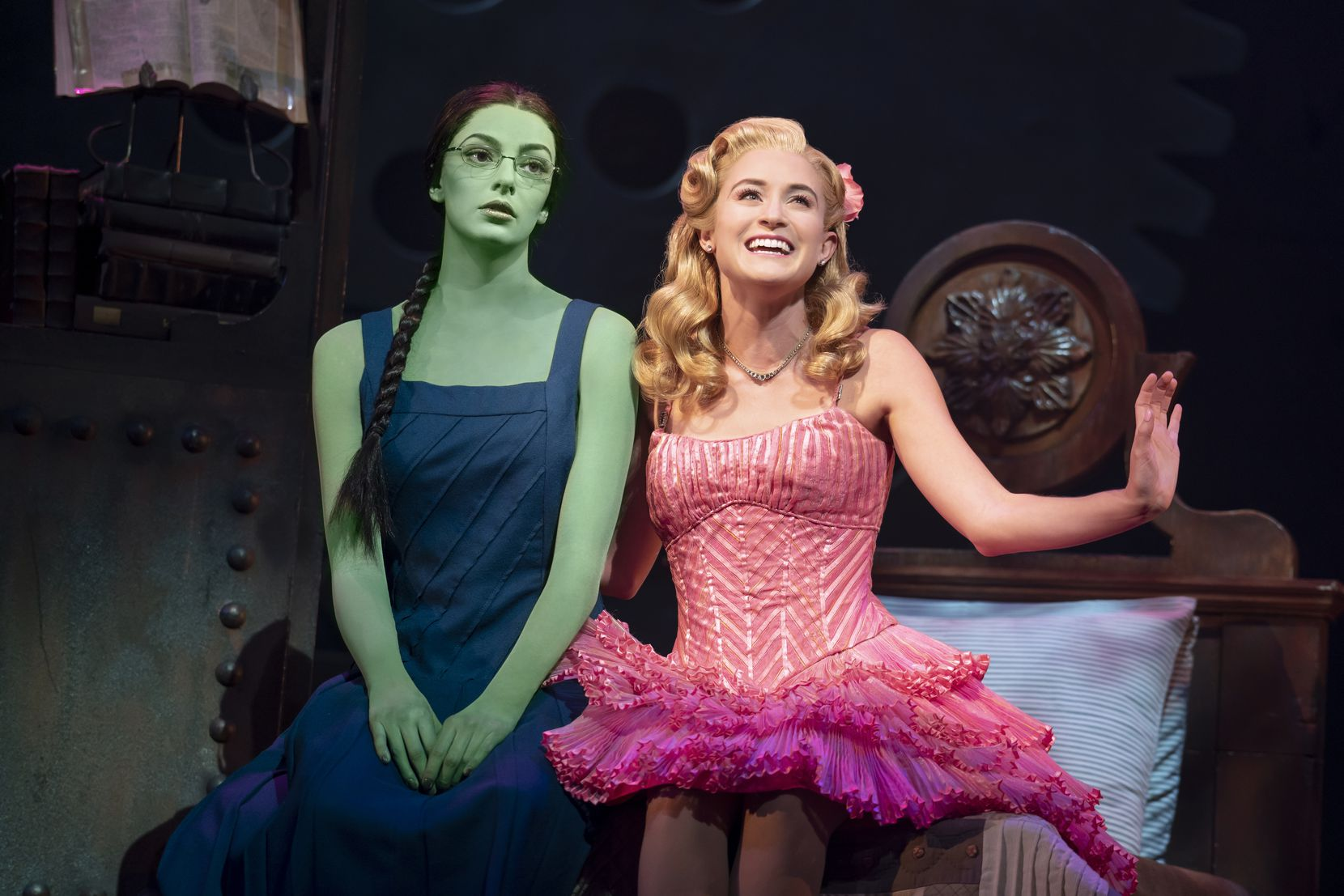 """Talia Suskauer as Elphaba, left, and Allison Bailey as Glinda in the North American tour of """"Wicked,"""" the first Broadway touring show to go on the road since the pandemic began."""
