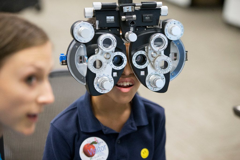 Miguel Bahena, 10, of Carrollton, Texas, gets a free eye exam provided by Essilor Vision Foundation during World Sight Day at Essilor of America on Oct. 13, 2016 in Dallas, Texas. (Ting Shen/The Dallas Morning News)