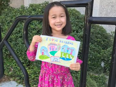 Ardent Lee, 7, is the winner of the Richardson Public Library's children's library card design contest.