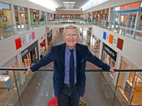 Allen Questrom posed for a photograph on the second level of NorthPark Center in Dallas in 2016.