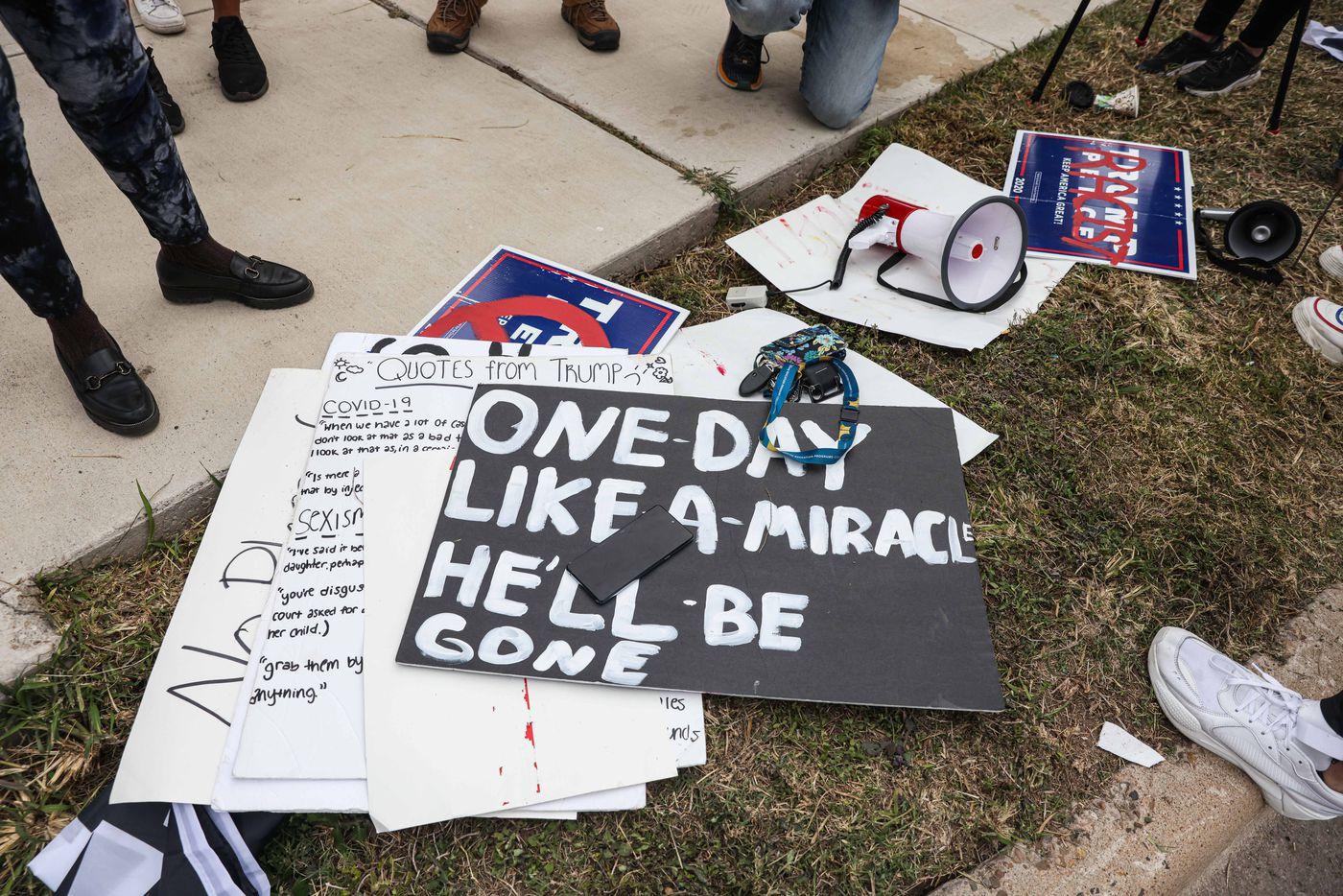 Posters in support of President-elect Joe Biden rest on the ground at S 10th St and Bales Rd during a rally as Trump is scheduled to visit part of the wall built under his mandate in McAllen on Tuesday, January 12, 2021.