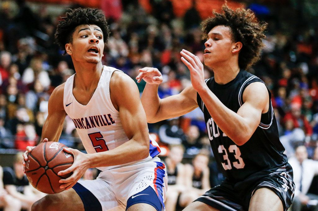 Duncanville junior guard Micah Peavy (5) looks for room against Denton Guyer junior Eli Stowers (33) during the first half of the Class 6A Region I championship boys basketball game at the Wilkerson-Greines Athletic Center in Fort Worth, Saturday, March 2, 2019. Duncanville won 66-62 in overtime. (Brandon Wade/Special Contributor