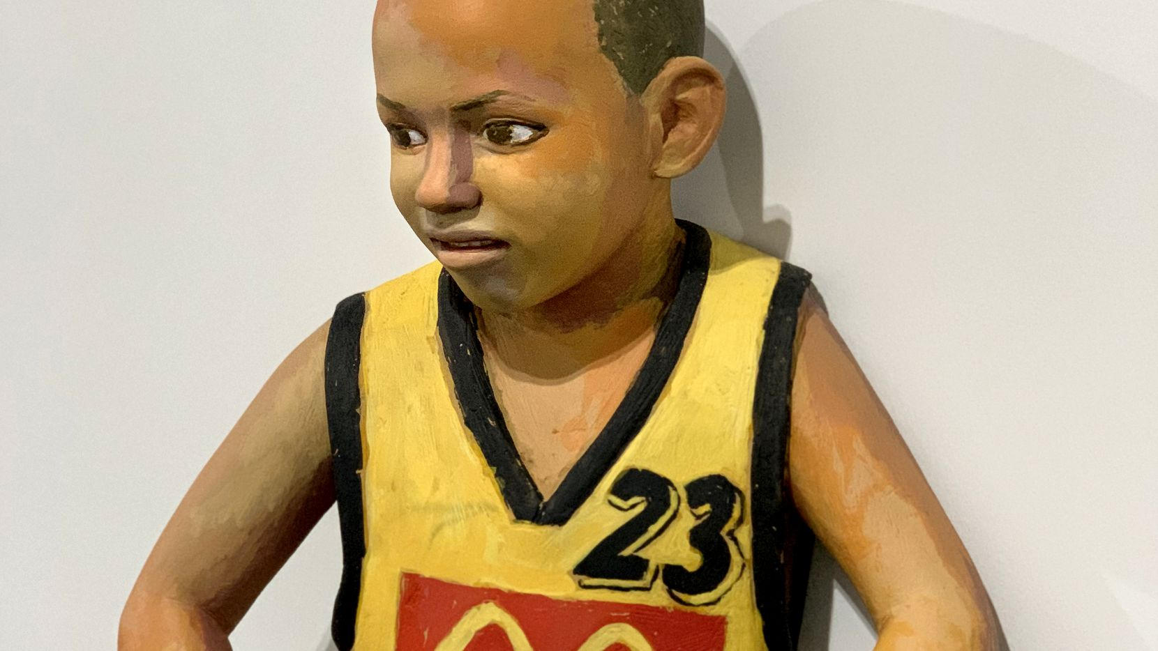 """John Ahearn's """"Jhovan"""" depicts a young basketball player."""