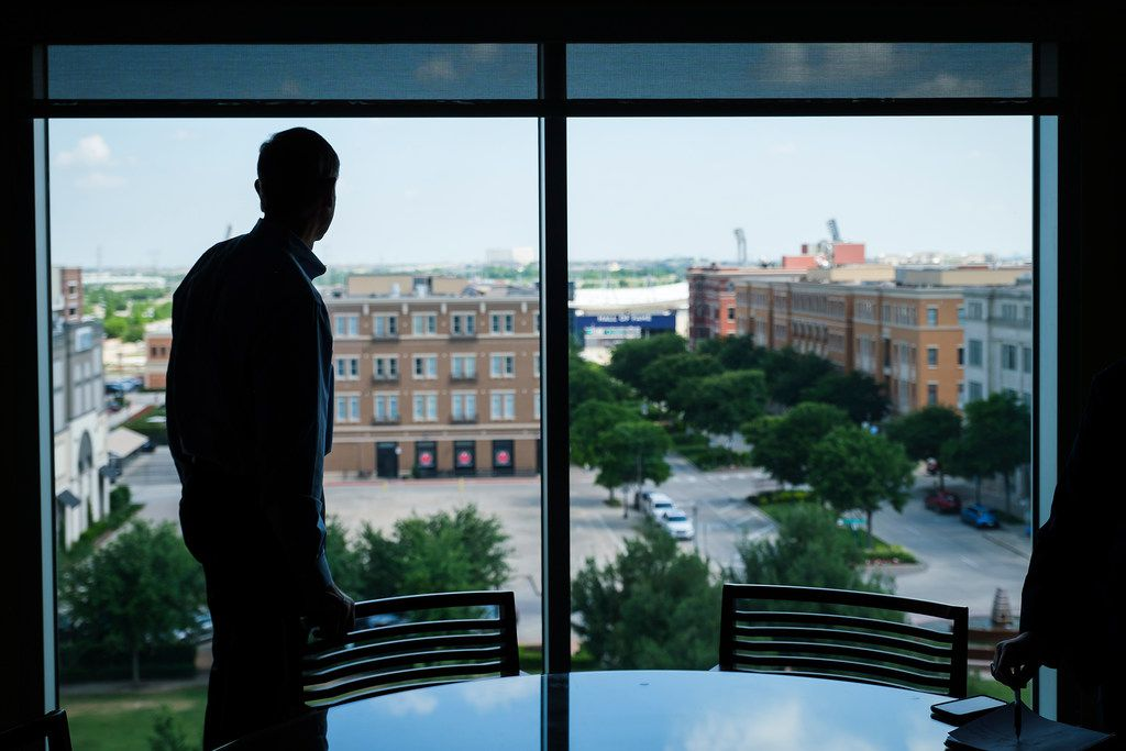 Frisco City Manager George Purefoy looks out the windows of his office in the municipal building that bears his name.