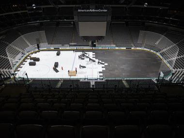 Crews cover the Dallas Stars ice after the NHL season was put on hold due to coronavirus on Thursday, March 12, 2020 at American Airlines Center in Dallas.