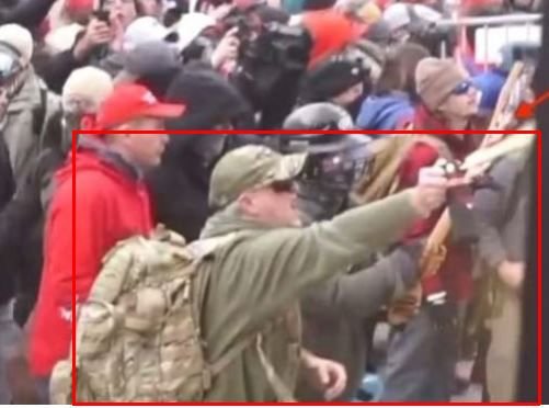 Daniel Caldwell is shown spraying a chemical irritant at Capitol police officers during the Jan. 6 insurrection, the FBI says.