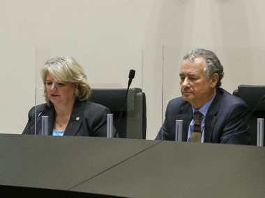 Dallas City Council member Cara Mendelsohn (left) and City Attorney Chris Caso listen to remarks during a council committee meeting at City Hall on Friday, Sept. 10, 2021, in Dallas.