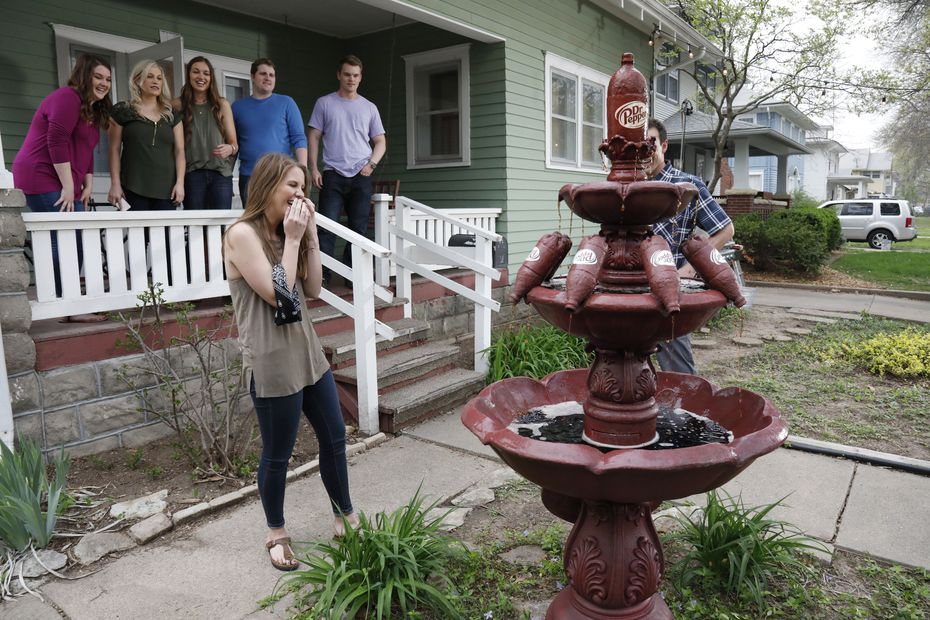 Claire Daniels, senior at Kansas State University, reacts after seeing her very own Dr Pepper fountain on Thursday, April 13, 2017, in Manhattan, Kan. Dr Pepper surprised Daniels with the fountain after seeing a tweet from her.