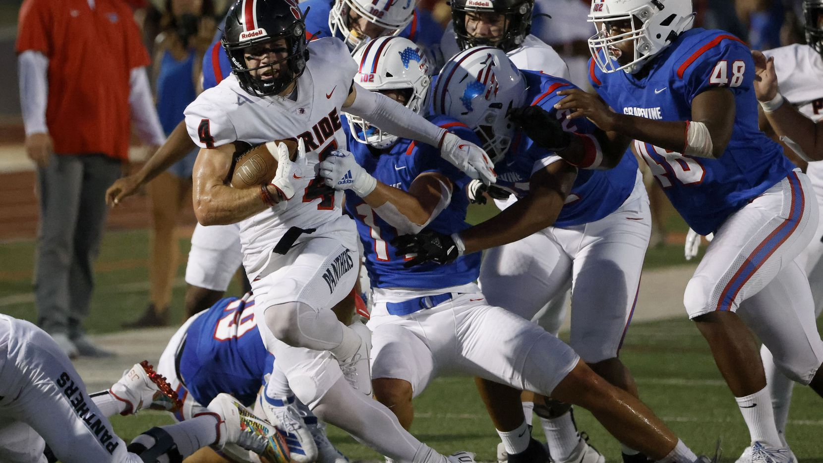 Grapevine defenders, including Brannan Mannix (11) try to tackle Colleyville Heritage receiver Hogan Wasson (4) during the first half of their high school football game in Grapevine, Texas on Aug. 27, 2021. (Michael Ainsworth/Special Contributor)