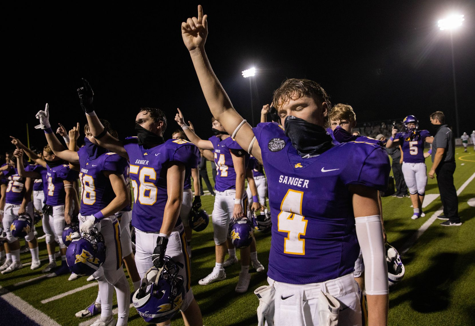 Sanger High School player Avery Walker (4) celebrates with his team after winning against Lake Worth High School on Sept. 4, 2020 in Sanger. Sanger won 49-35. (Juan Figueroa/ The Dallas Morning News)