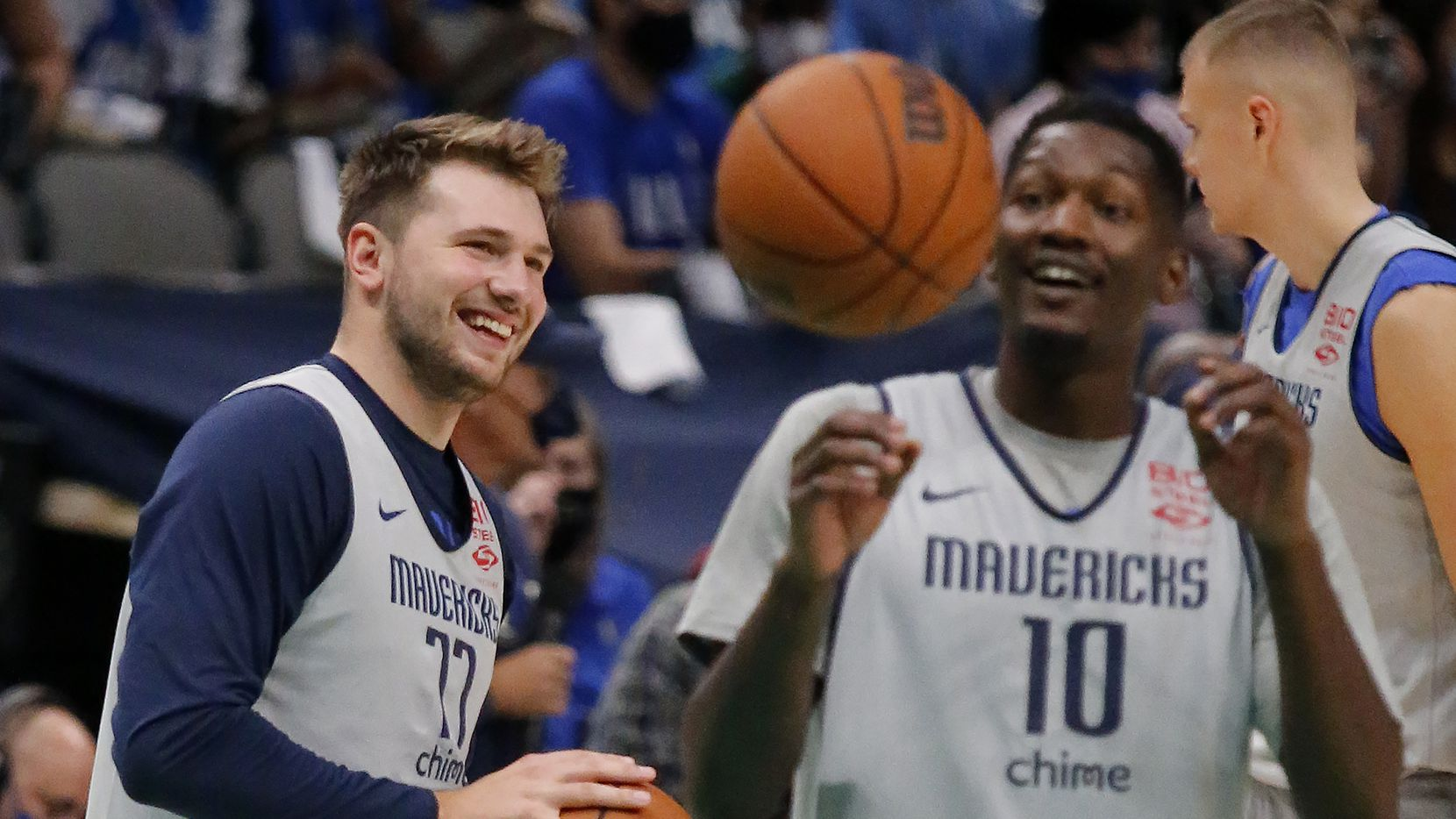 Dallas Mavericks guard Luka Doncic (77) shares a laugh with Dallas Mavericks forward Dorian Finney-Smith (10) during warm ups as the Dallas Mavericks held their Mavs Fam Jam, a scrimmage free to the public at the American Airlines Center in Dallas on Sunday, October 3, 2021.