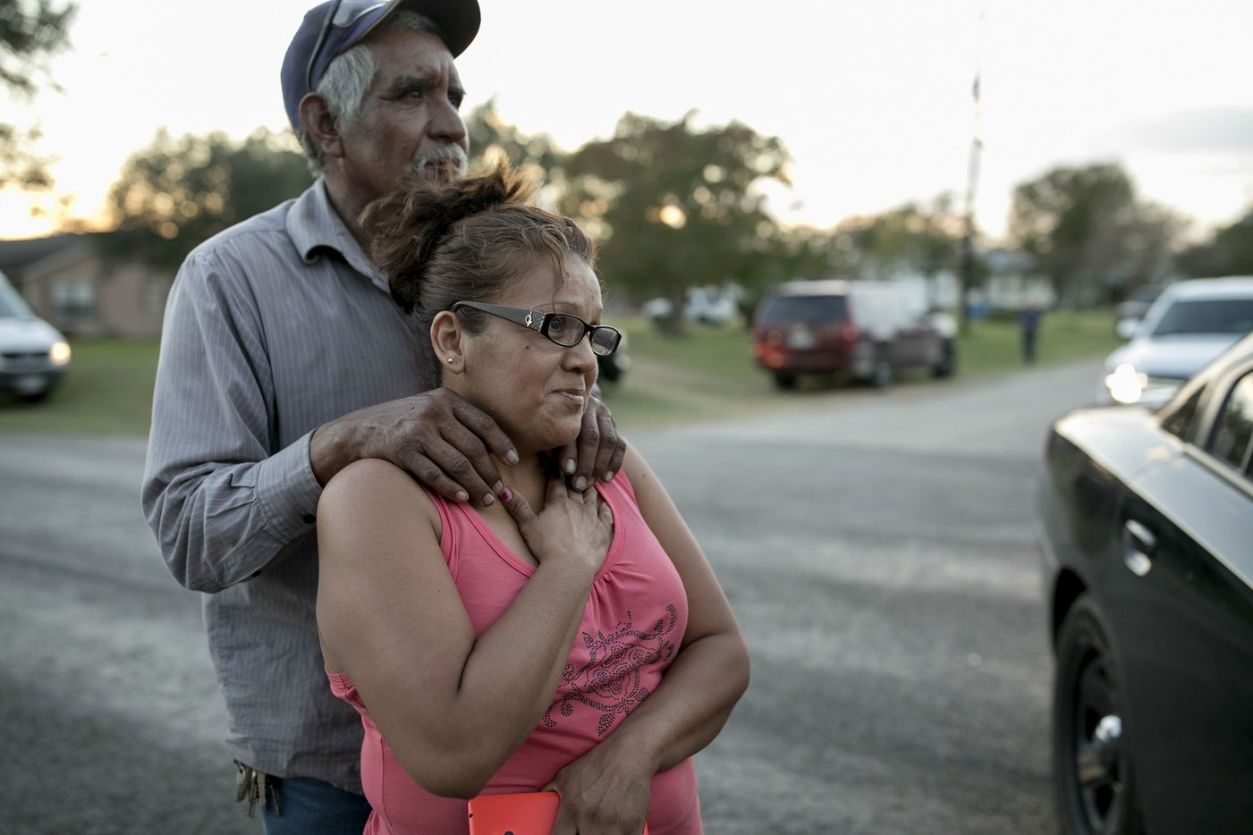 Enrique and Gabby Garcia watch investigators at the scene of a mass shooting at the First Baptist Church in Sutherland Springs, Texas, on Sunday Nov. 5, 2017.