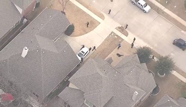 NBC5's helicopter captured video of Dallas police and officers with the Dallas County Community College District surrounding a home in the 12200 block of Jackson Creek Drive. An armed man went through the open garage and into the house, where he was confronted by an armed homeowner, police said.