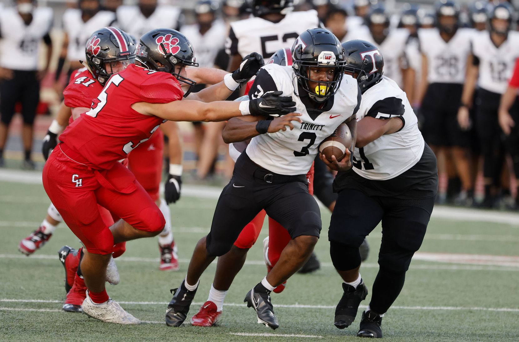 Colleyville's Nathan Miller (left) fails to contain Euless Trinity' running back Gary Maddox (2) as he runs for a touchdown during the first half of a high school football game in Grapevine, Texas on Friday, Sept. 10, 2021. (Michael Ainsworth/Special Contributor)