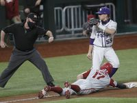 TCU 3rd baseman Brayden Taylor (55) tags out a sliding Brady Slavens (17) after he was cut short of advancing a base during the top of the 2nd inning of play. Texas Christian University played the University of Arkansas in conjunction with the State Farm College Baseball Showdown tournament held at Globe Life Field in Arlington on February 22, 2021.