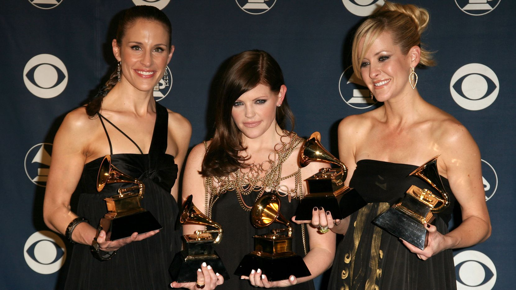 In this 2007 photo, Emily Robison, from left, Natalie Maines and Martie Maguire, of the Dixie Chicks, winners for that year's Album of the Year, Record of the Year, Song of the Year, Best Country Performance by a Duo or Group with Vocal and Best Country Album, stand in the pressroom at the 49th Annual Grammy Awards at the Staples Center in Los Angeles, Calif.