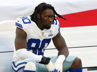 Dallas Cowboys defensive end DeMarcus Lawrence (90) on the bench in a game against the Pittsburgh Steelers during the first quarter of play at AT&T Stadium in Arlington, Texas on Sunday, November 8, 2020.